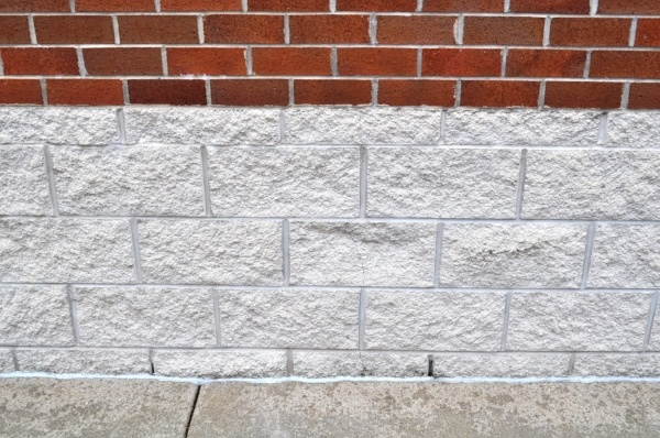 """Figure 2: Control joints in this 4"""" CMU veneer were placed 24'-0"""" o.c. to accommodate the clay brick expansion above.  However, CMU control joints should have been placed no more than 12'-0"""" o.c., with horizontal joint reinforcement in the CMU spaced appropriately."""