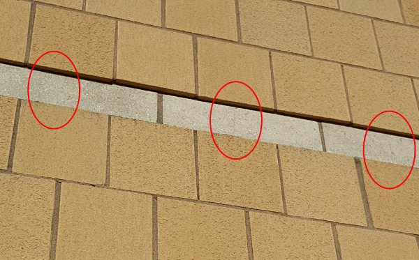 Figure 8: Approximately 80% of all CMU units are cracked in the accent bands on this large hospital project due to differential movement of the shrinking CMU band bonded to large expanses of clay brick veneer.