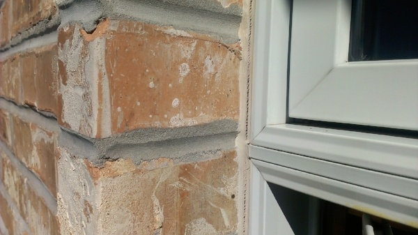 Figure 9: This sealant joint prematurely failed because there was no room to install a backer rod for a properly formed sealant joint. Designers should draw and dimension a gap on all four sides of windows.